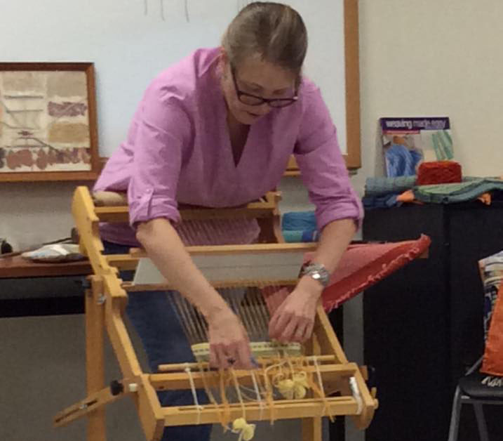 teacher showing weaving experiment