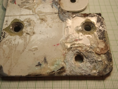 Image of aluminum alloy plate in various states of corrosion.