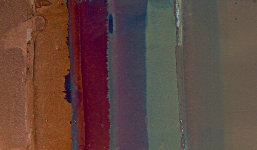 A slide with a variety of colored copper oxide films on it.